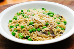 Peas pesto with orzo pasta and sauteed mushrooms Stock Image