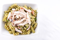 Peas pesto with rotini, diced grilled chicken Royalty Free Stock Image