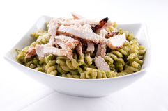 Peas pesto with rotini and diced grilled chicken, a delicious he Stock Images