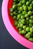Peas in pink bowl Stock Image