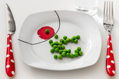 Peas on a plate with a glass of water, dieting concept Royalty Free Stock Photography