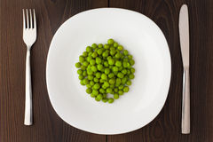 Peas on a plate Stock Photography
