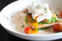 Peas poached eggs Royalty Free Stock Photo