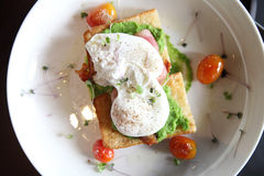 Peas poached eggs Stock Photography