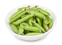Peas pod bowl Royalty Free Stock Photo
