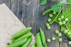 Peas and pods of peas on a dark background. Royalty Free Stock Photos