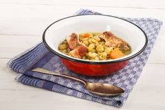 Peas soup with carrots and pork meat in an enamel bowl Stock Images
