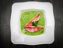 Peas soup with mullet fillet Royalty Free Stock Photos
