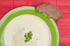 Peas soup with a slice of bread Royalty Free Stock Photo