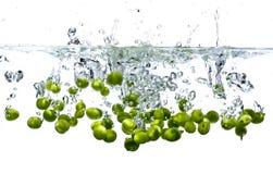 Peas splashing Royalty Free Stock Image