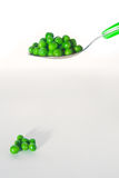 Peas on a spoon Royalty Free Stock Images