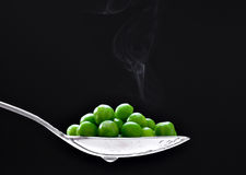 Peas in spoon Stock Photography