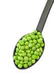 Peas in a spoon Royalty Free Stock Images