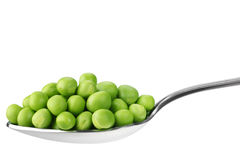 Peas in spoon Royalty Free Stock Photo