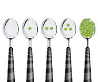 Peas and spoons Stock Images