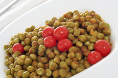 Peas and tomatoes Royalty Free Stock Photos