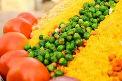 Peas, tomatoes and sev for bhelpuri. Preparation. Closeup shot shot showing the ingredients and how they are displayed on streetside vendors Stock Photo