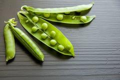 Peas vegetable closeup isolated on black background Stock Image