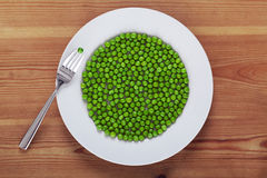 Peas on a white plate Stock Photography