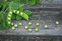 Peas on wooden background Stock Images