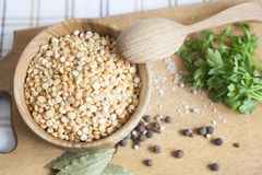 Peas. In a wooden bowl, wooden spoon, herbs stock photography