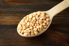 Peas in a wooden spoon Stock Photography