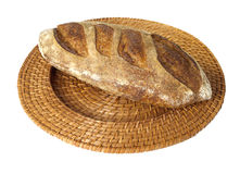 Peasant batard bread on wicker tray Royalty Free Stock Photography