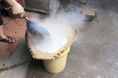 Peasant cooking rice Stock Photos