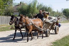 Peasant family in cart Royalty Free Stock Images