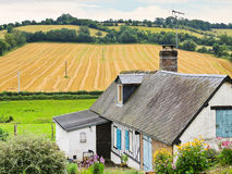 Peasant farm and harvested field in Normandy Royalty Free Stock Image