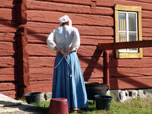 A peasant. Girl in an old peasant clothing preparing to work Royalty Free Stock Photos