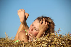 Peasant girl resting in haystack Royalty Free Stock Images