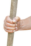 Peasant hand holds old wooden cudgel Stock Photos