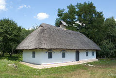 Peasant house. Wattle and daub house with thatched roof Stock Photo
