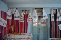Peasant House before Christmas. Inflamed candle Royalty Free Stock Image