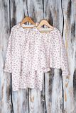 Peasant nightgown and top. On rustic background. Pleasant floral pattern. Quality fashionable sleepwear for girls Stock Photography