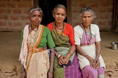 Peasant. Three elderly women sitting on the bench in the Indian village stock photo