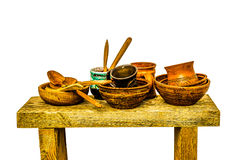 Peasant utensil on a wooden bench Royalty Free Stock Photos