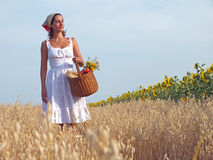 Peasant woman. Walk through a field with a basket full of food, photography royalty free stock image