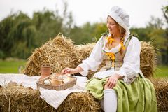 The peasant woman sat down on a picnic in the hay Stock Images