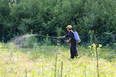 Peasant woman spraying herbicides Royalty Free Stock Photography