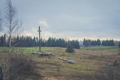 Peasant wooden cross on the mountain near the river bank, lake. Royalty Free Stock Photo
