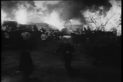 Peasants fleeing burning village stock footage