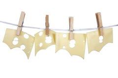 Peases van kaas op een kabel Stock Afbeeldingen