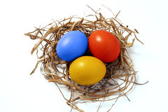 The Peaster egg. The Peaster dyed egg on bunch of straw.The Type overhand Stock Photo