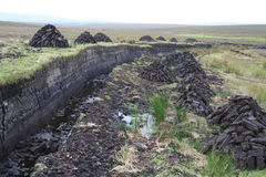 Peat bogs. And dug up peat piles for home fires, Achill Island, County mayo, Ireland royalty free stock photo