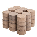 Peat briquettes for growing seedlings Stock Photos