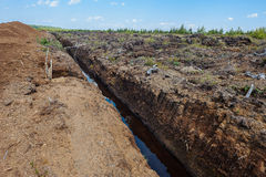 Peat extraction in a field Stock Photos