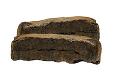 Peat fuel briquettes. Biofuels, bio fuels . Peat fuel briquettes for use in furnaces and boilers heating. Economical fuel to heat homes and premises stock image