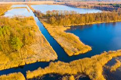Peat lands aerial. Beautiful spring landscape. Bright sun shining above rural area stock photography